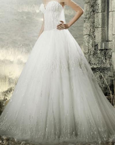 """مجموعة أبولو لفساتين الزفاف """"سكاي"""" الأناقة والرقي."""